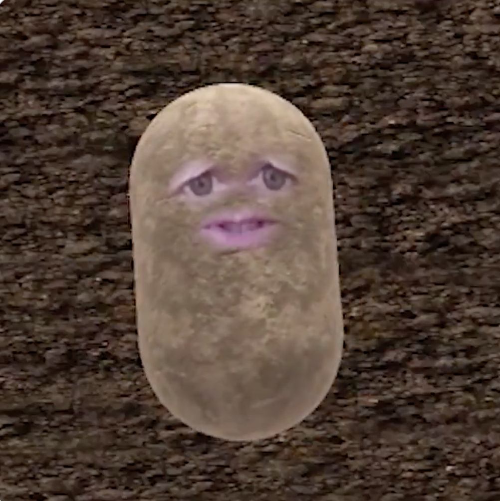 A disconcerting potato with human eyes and a mouth and teeth