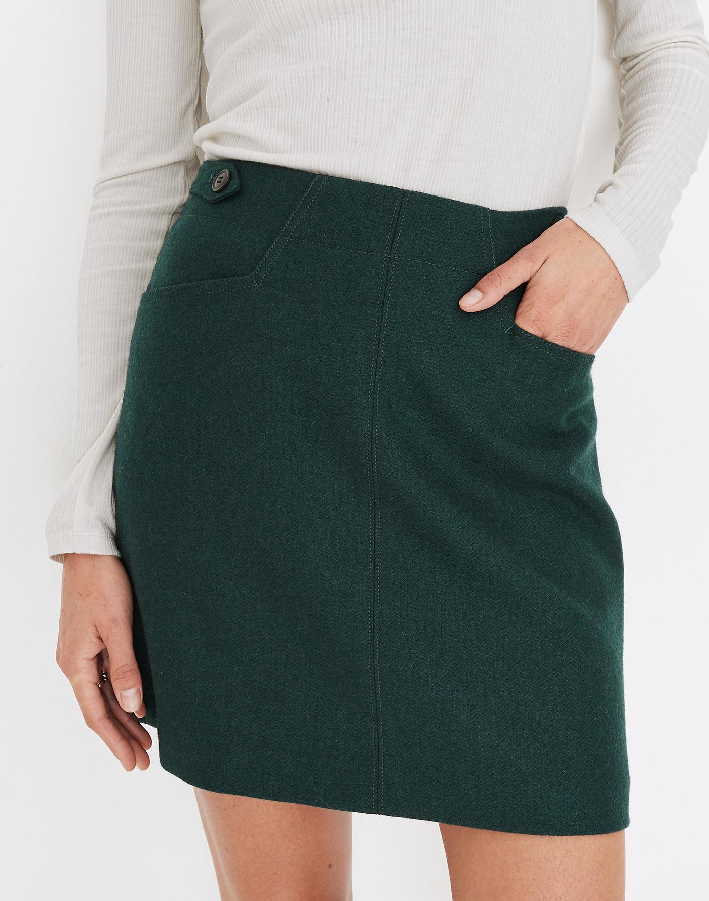 Model wearing green skirt