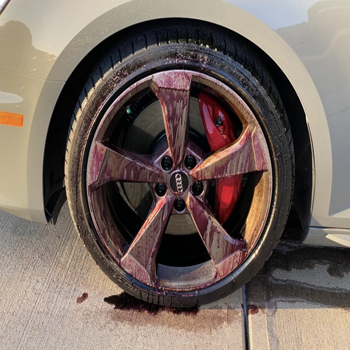 a reviewer's tire looking purple and dirty