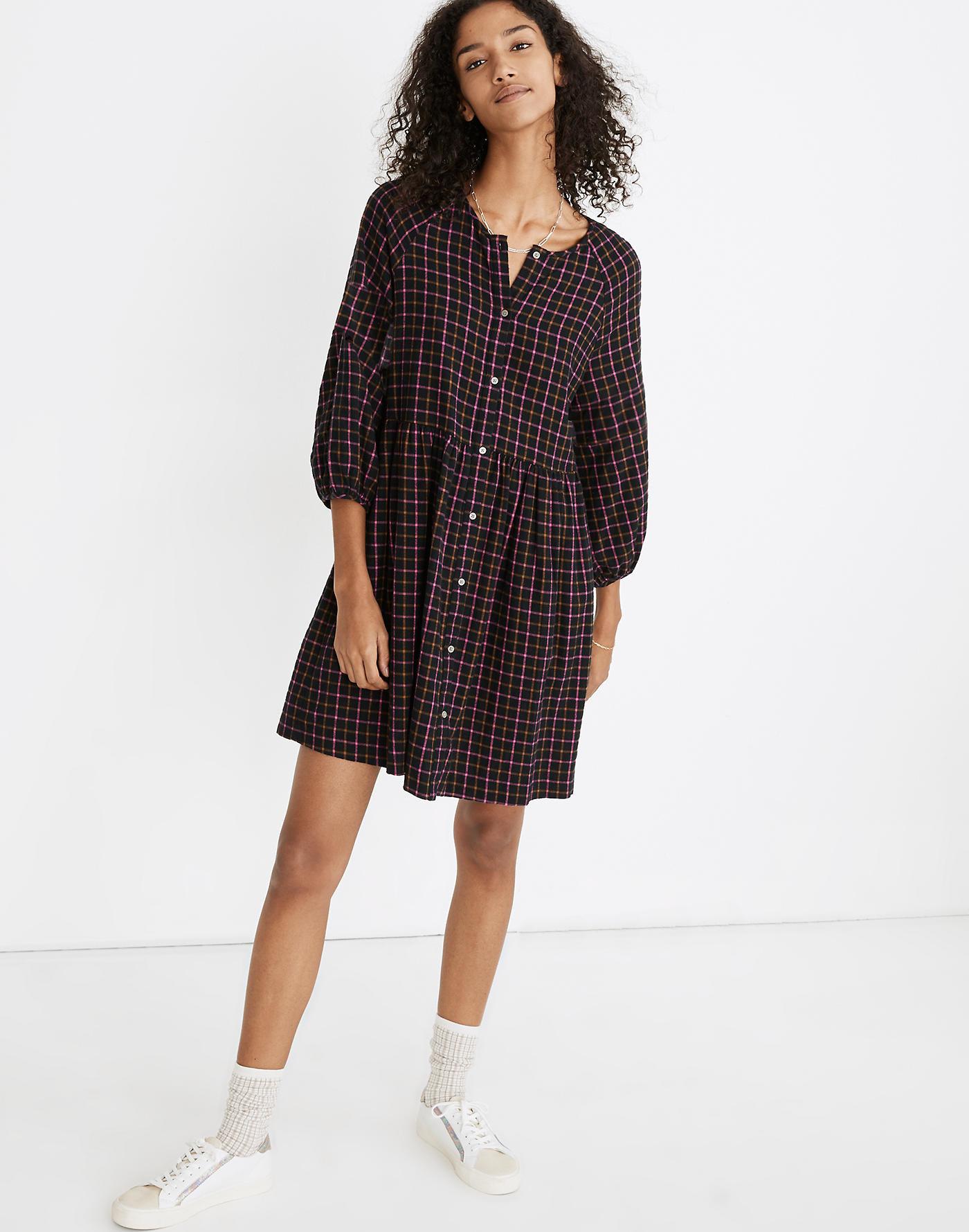Model wearing plaid dress