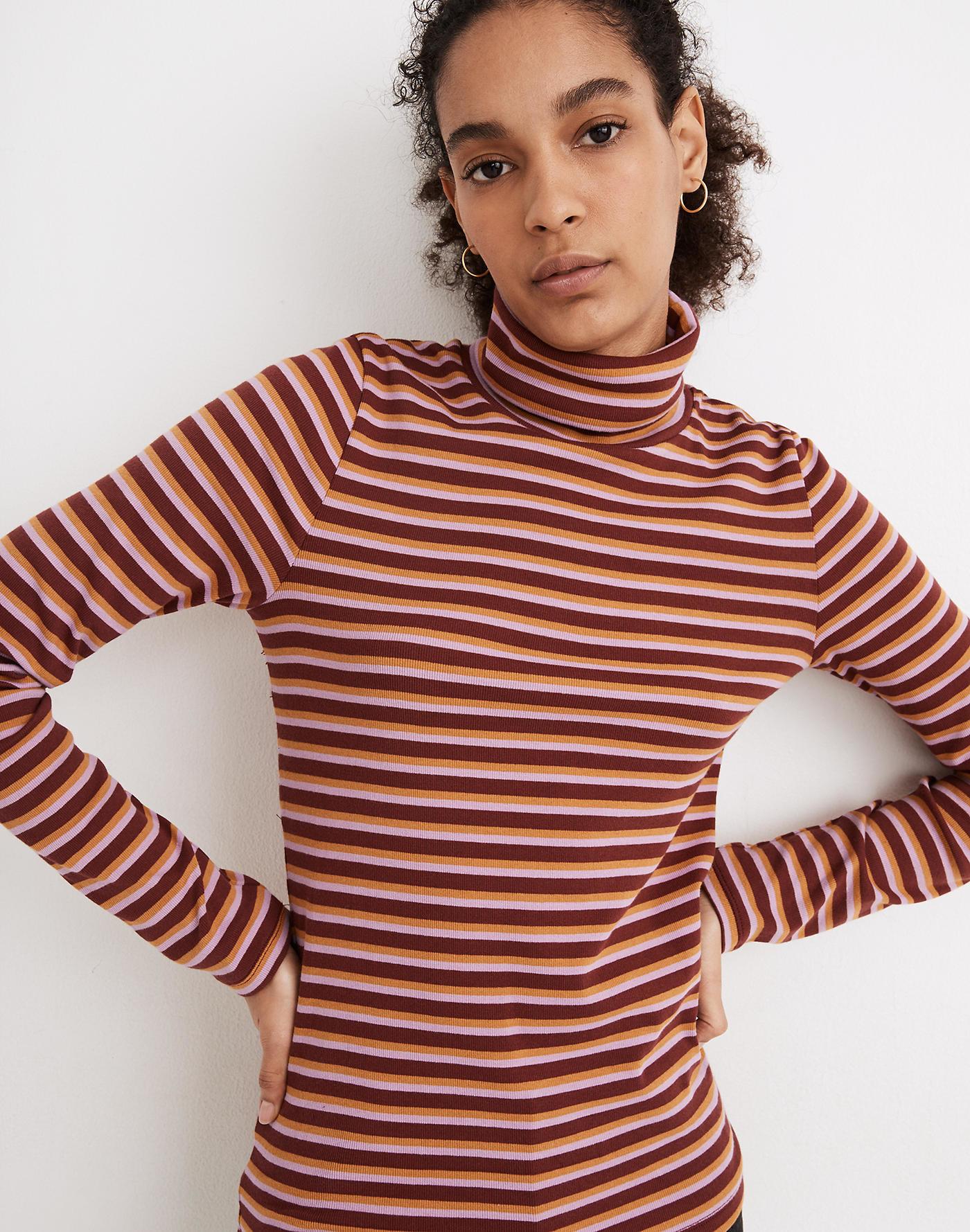 Model wearing ribbed pink turtleneck