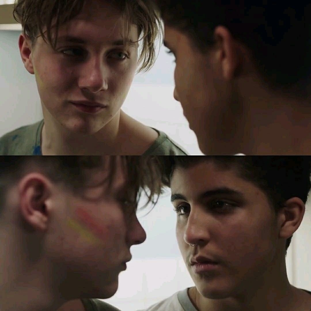 Matteo and David looking at each other with deep love and admiration