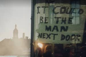 """A sign that says """"It could be the man next door"""""""
