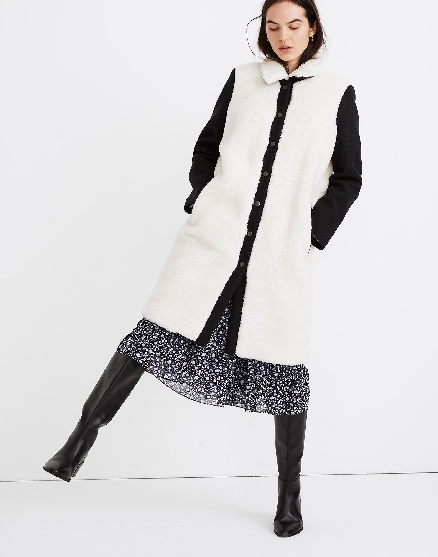 Model wearing black and white coat