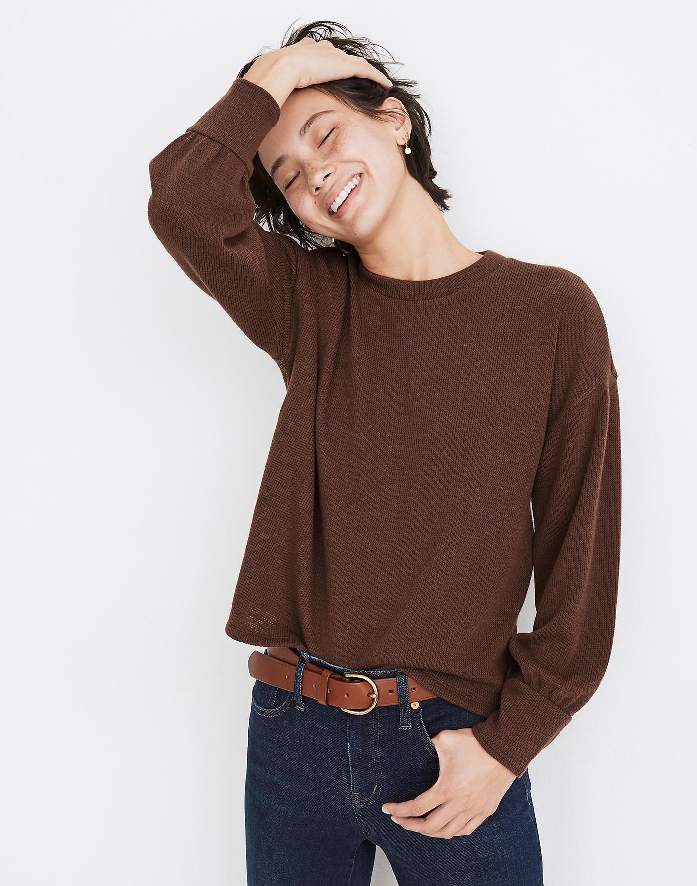 Model wearing brown top
