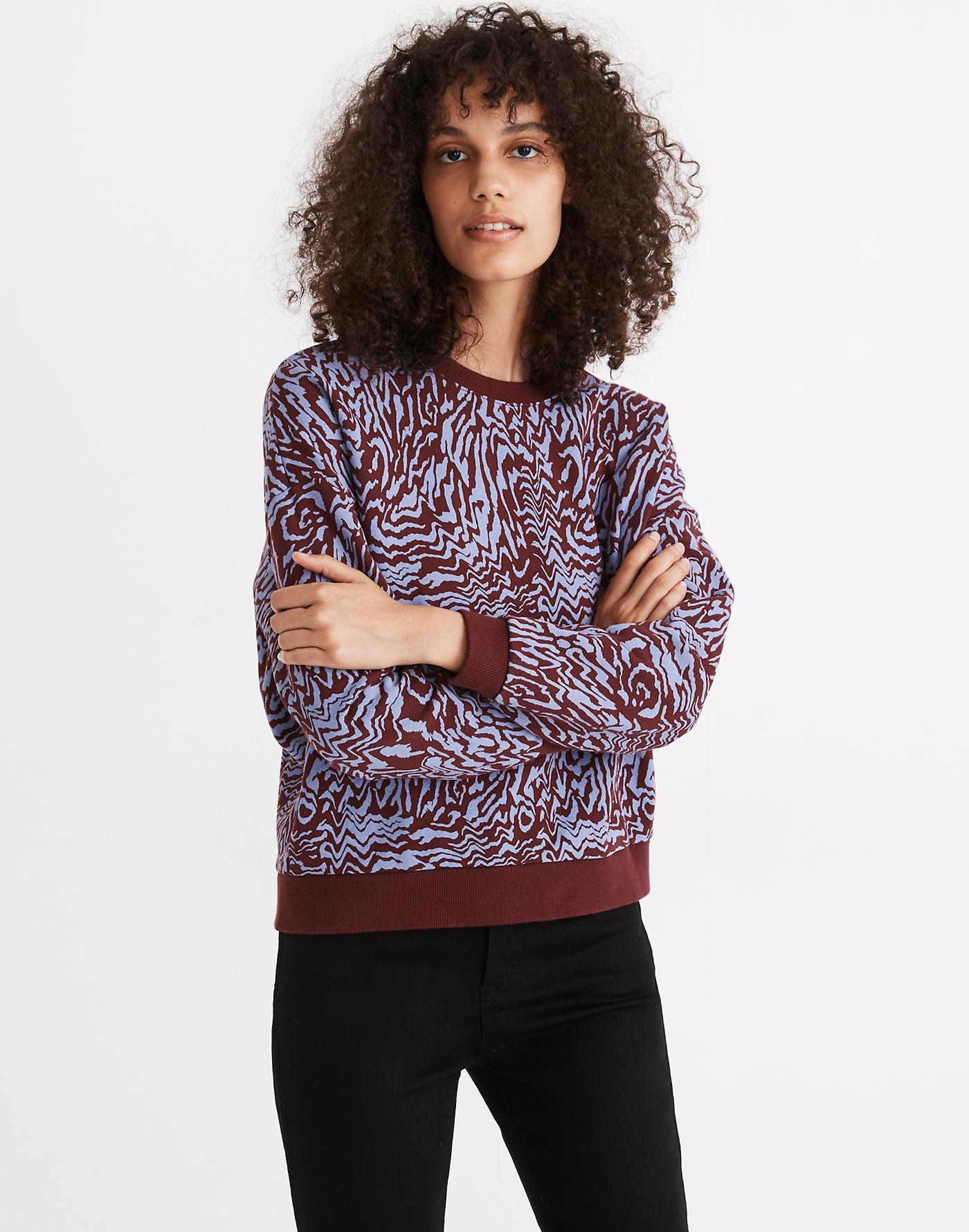 Model in the lavender and maroon zebra print sweatshirt