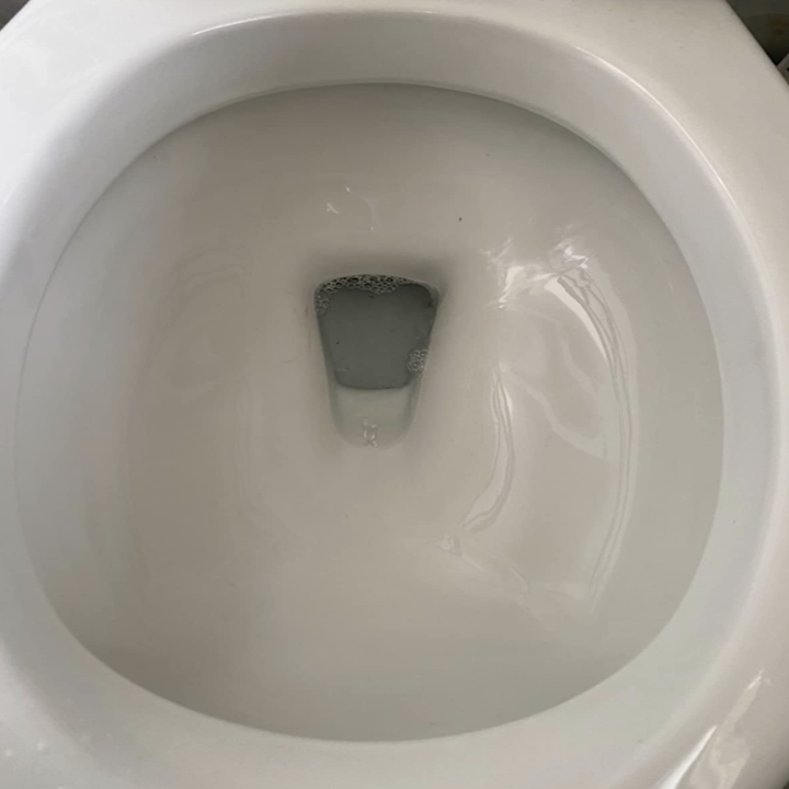 the same toilet now looking completely clean