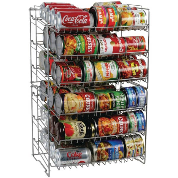 can rack with cans of soda, soup, and vegetables stacked on the shelves