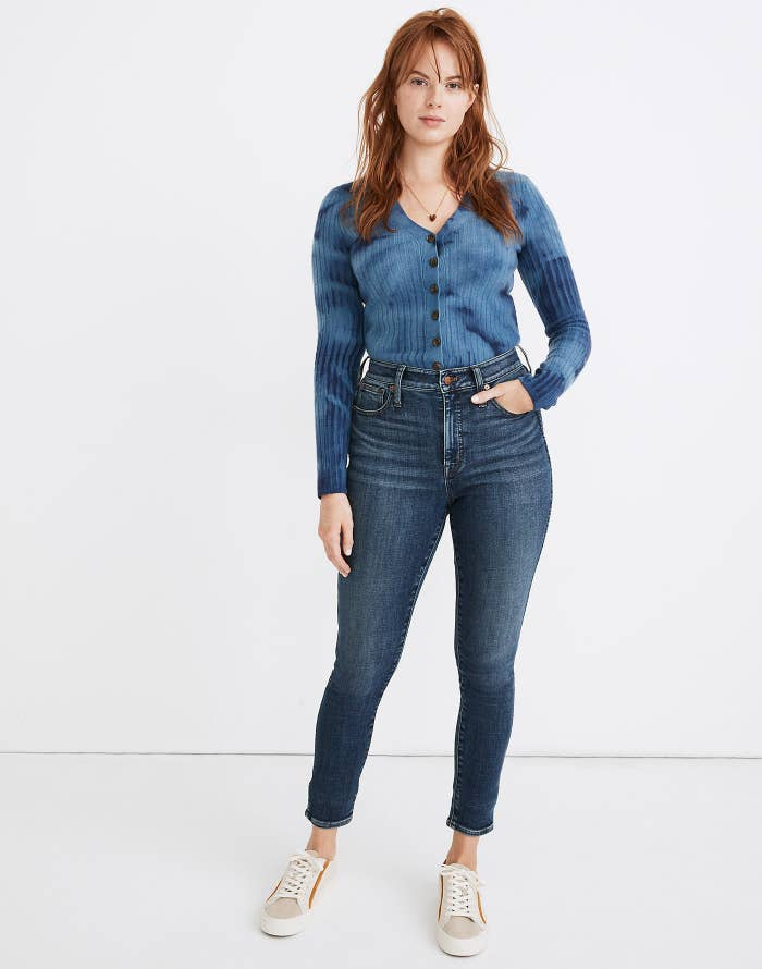 Model in denim and blue top
