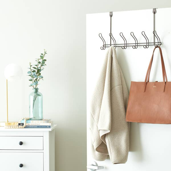 over-the-door coat rack holding a coat and purse