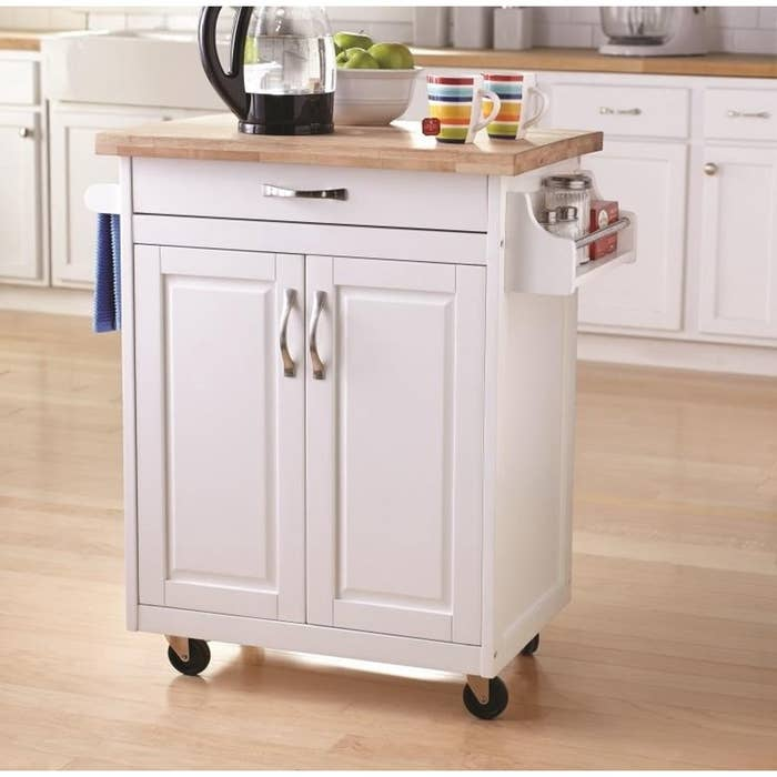 white kitchen island cart with wood top and spice rack on the side