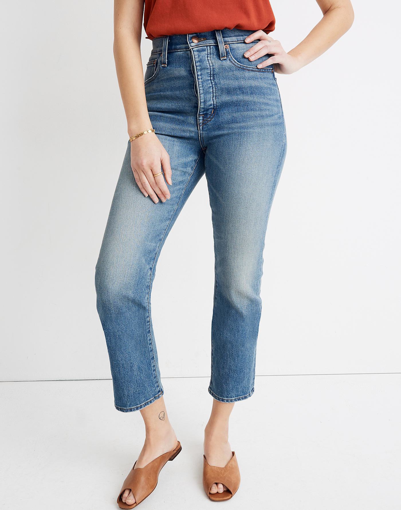 Model wearing medium wash jeans