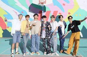 BTS posing on a basketball court