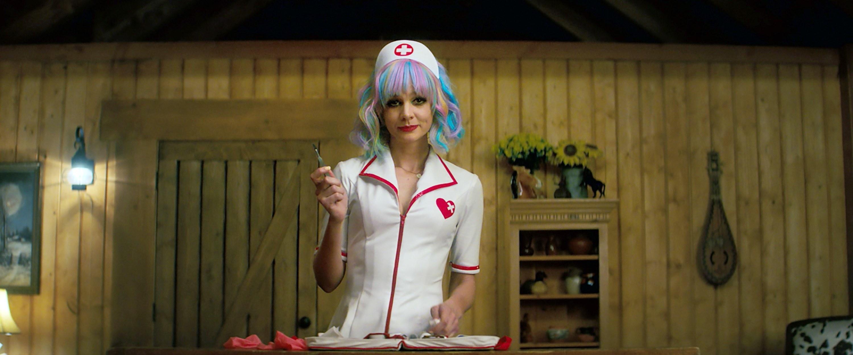 Cassie in a nurse's costume and a multi-colored wig