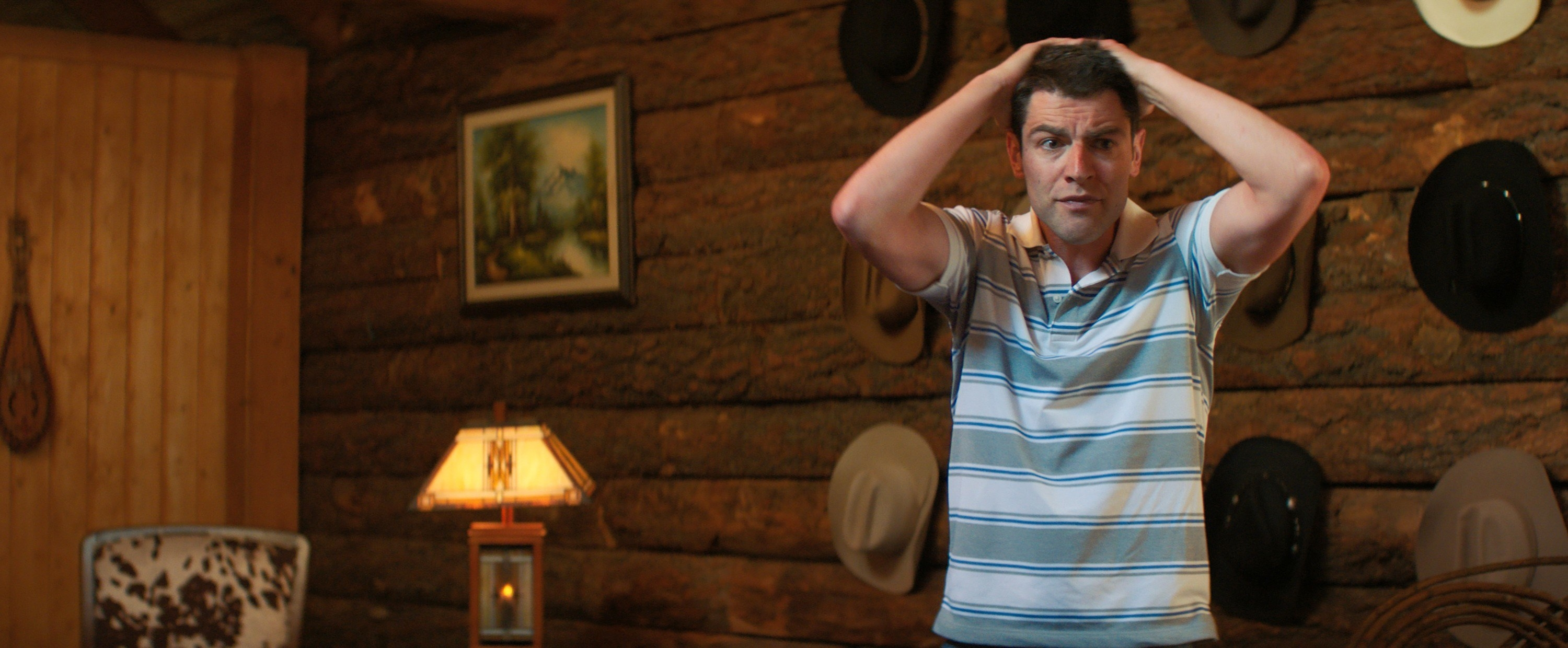 Max Greenfield with his hands on his head in Promising Young Woman