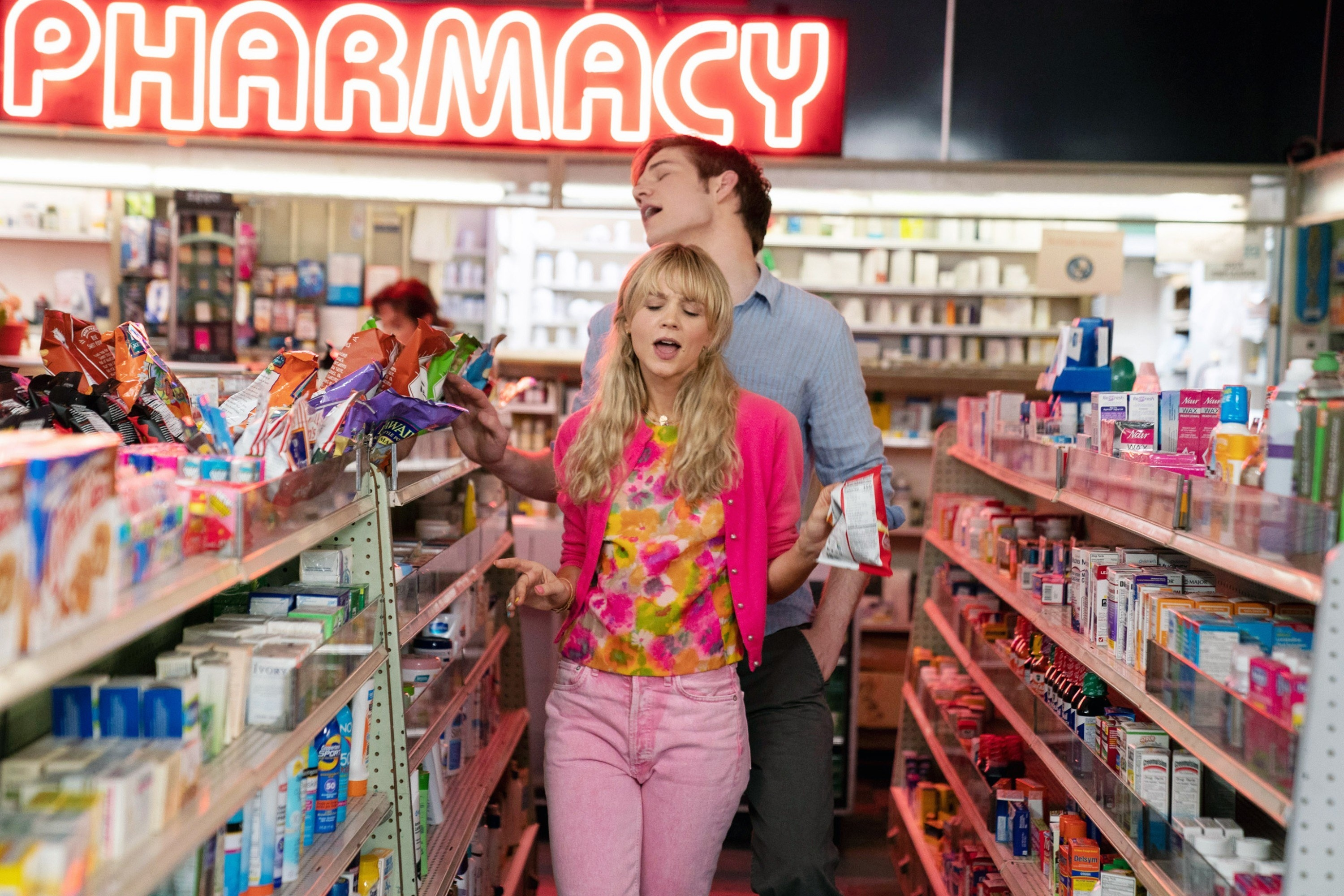 Carey and Bo singing in Promising Young Woman as they walk down a store aisle