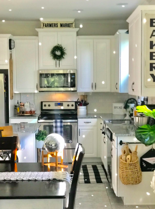 Reviewer's kitchen with glowing dots as small disco ball on table is hit by sunlight through window