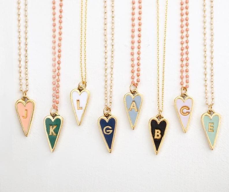 The ball chain necklaces with think colorful heart pendants featuring gold initials