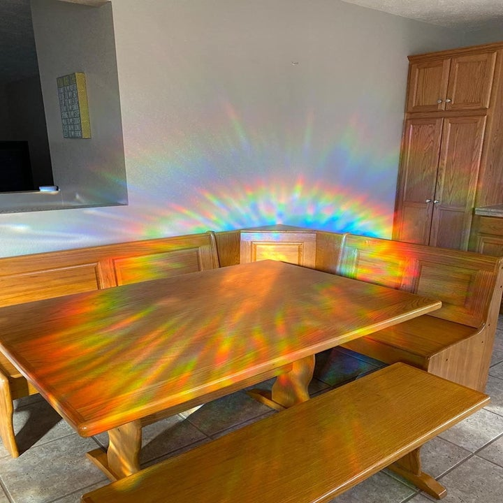 Reviewer image showing the rainbow effect from the window cling in their kitchen