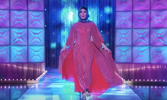 Jackie walking down the RPDR runway in a USA stars and stripes hajib