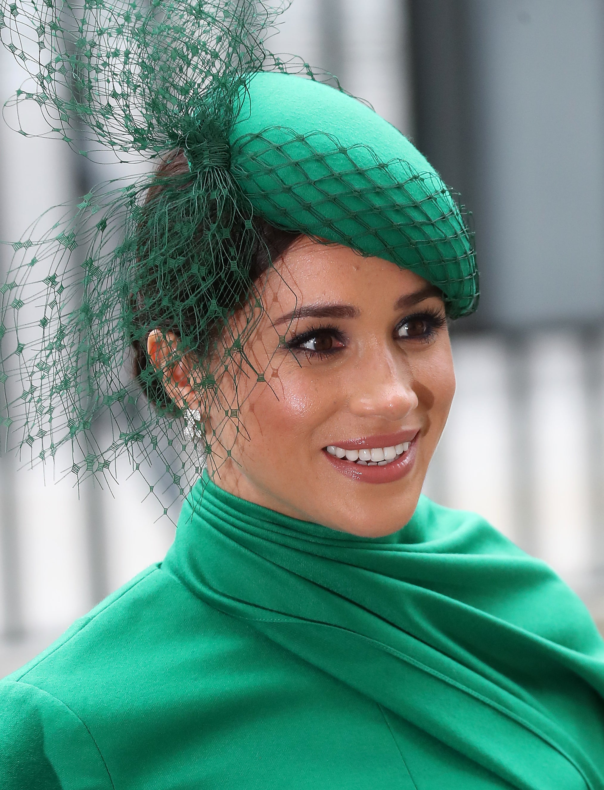 Meghan Markle wearing a green Emilia Wickstead dress with a matching green William Chambers hat