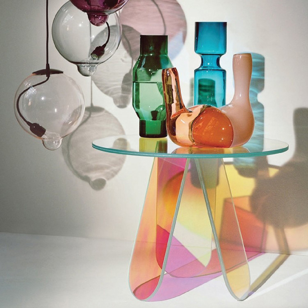 Small side table with three rounded legs and flat top circular tabletop. The material is multi-colored and iridescent.