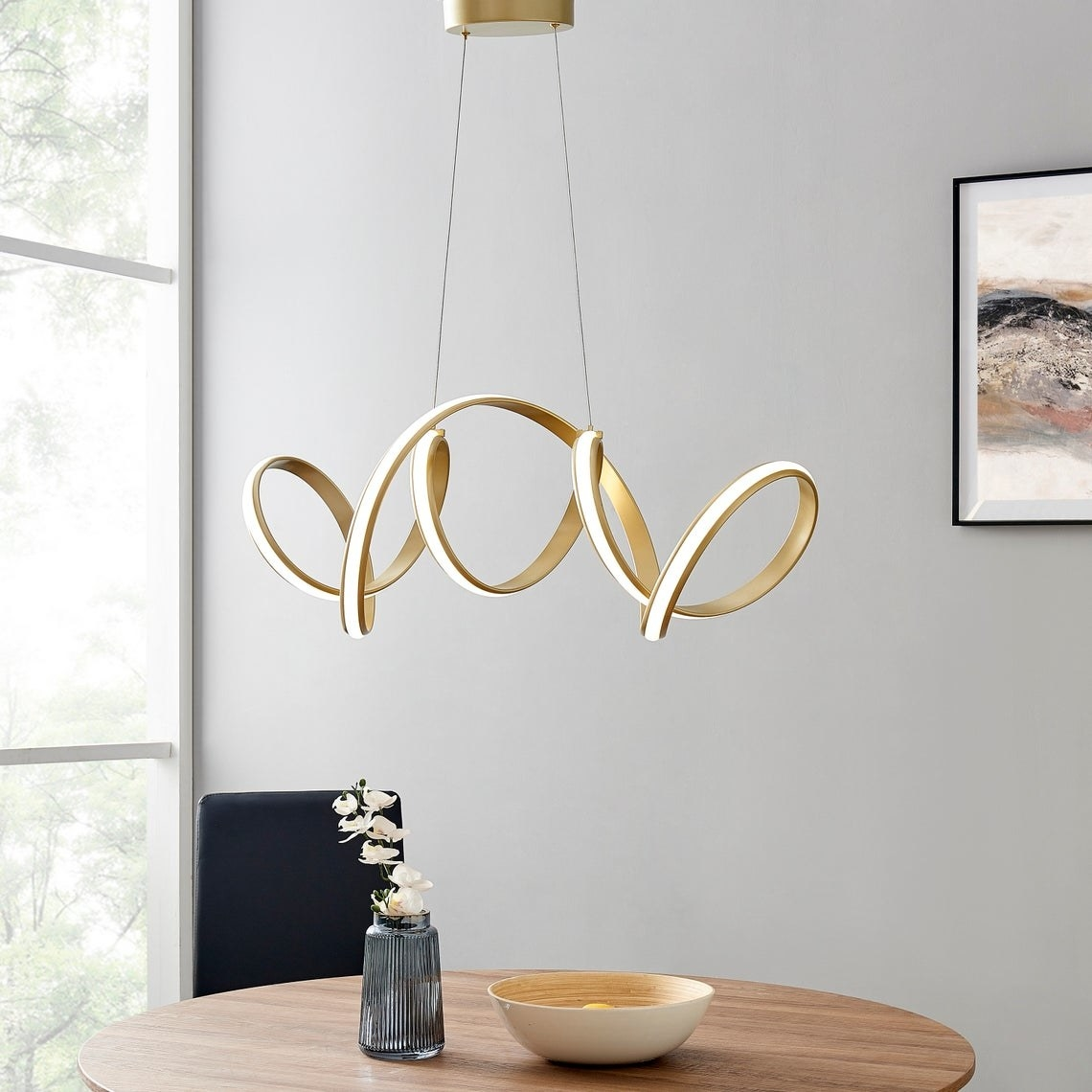 Twisty LED light hanging from ceiling with gold details