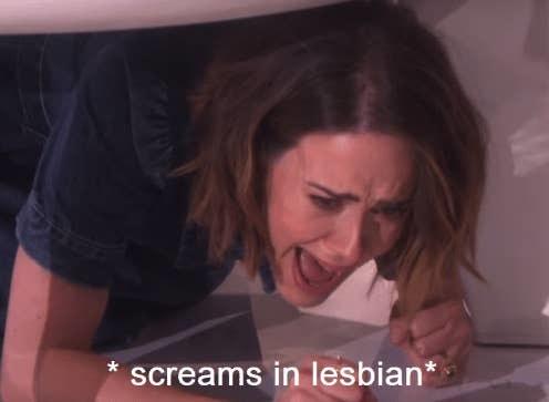 Sarah Paulson screaming under a table
