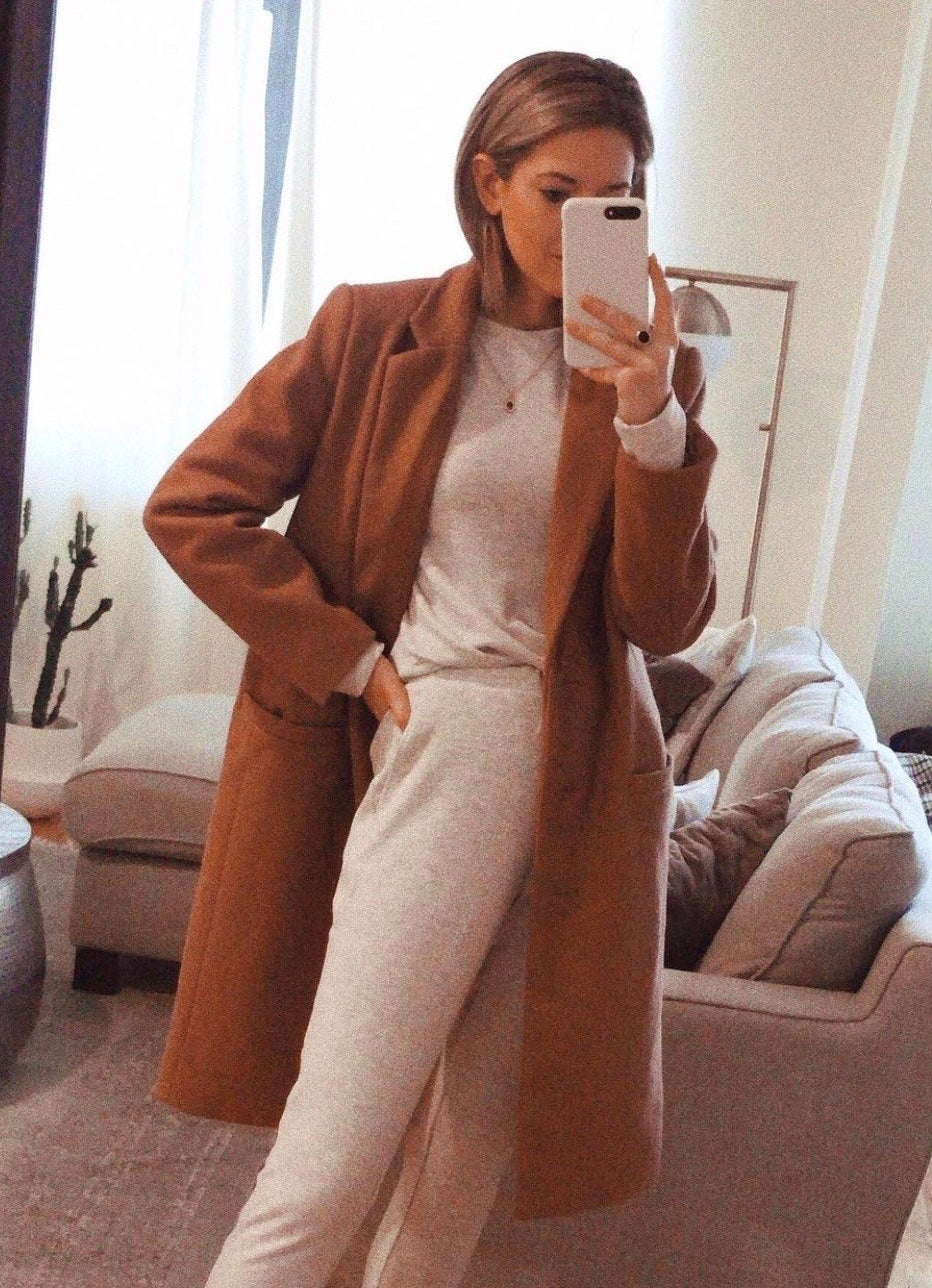 Reviewer wearing the coat in tan