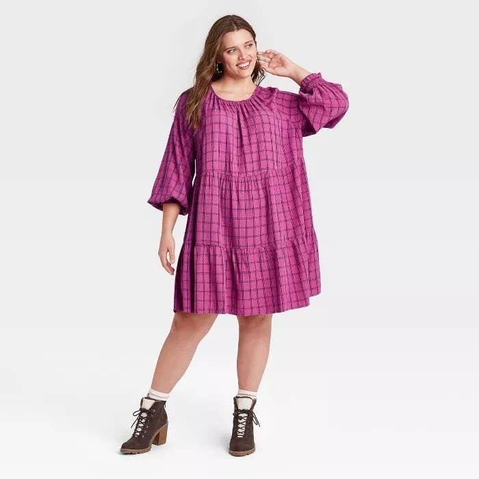model wears pink plaid baby doll dress