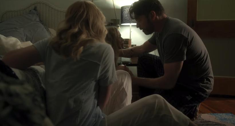 Rain's parents consoling her in her bedroom