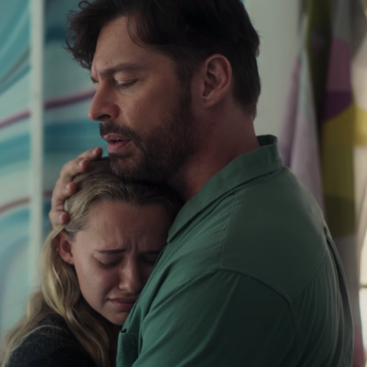 Rain and her dad (played by Harry Connick Jr.) embracing in a hug