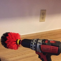 The brush attached to a Reviewer's drill