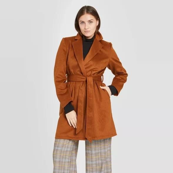 model wears brown overcoat