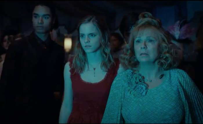 Regé-Jean Page standing next to Emma Watson and Julie Walters