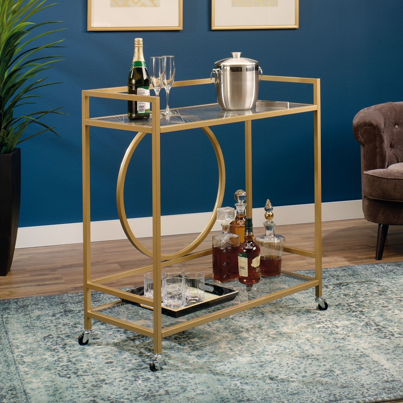 A gold rectangular art cart