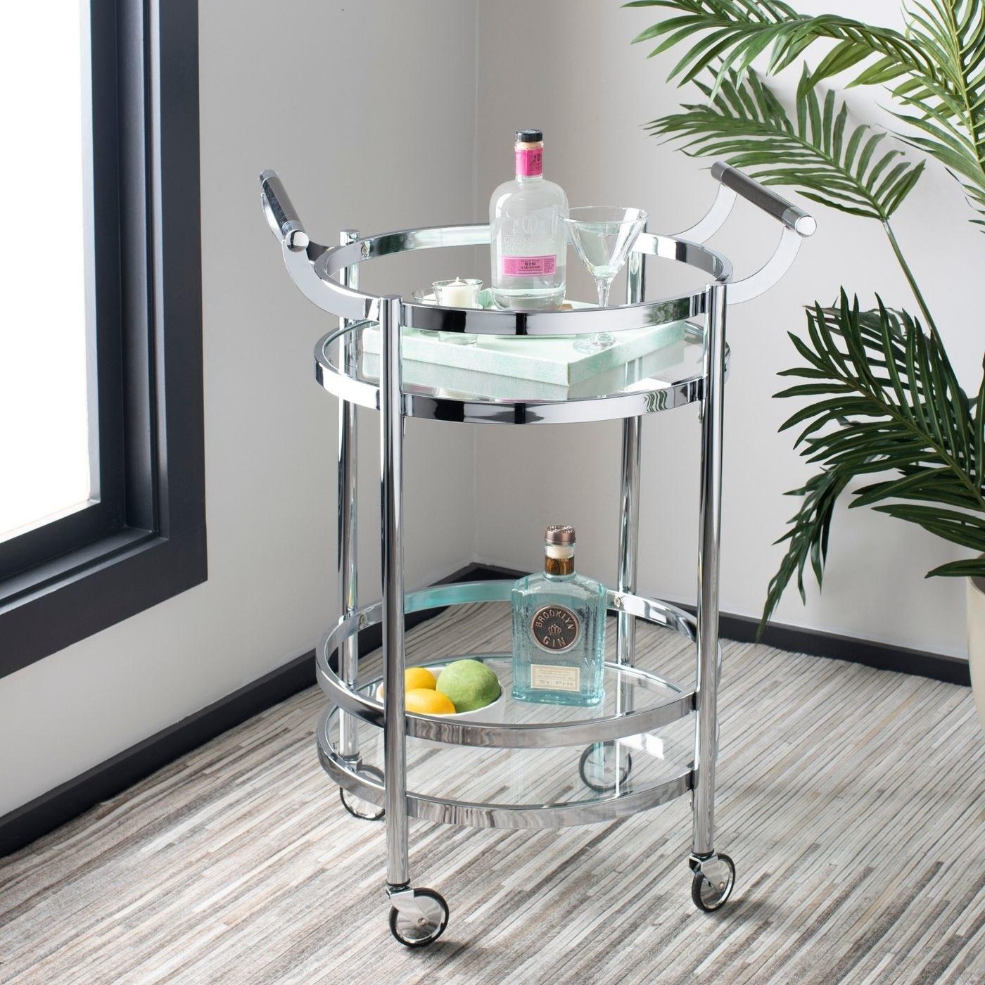 A chrome 2 tier round bar cart