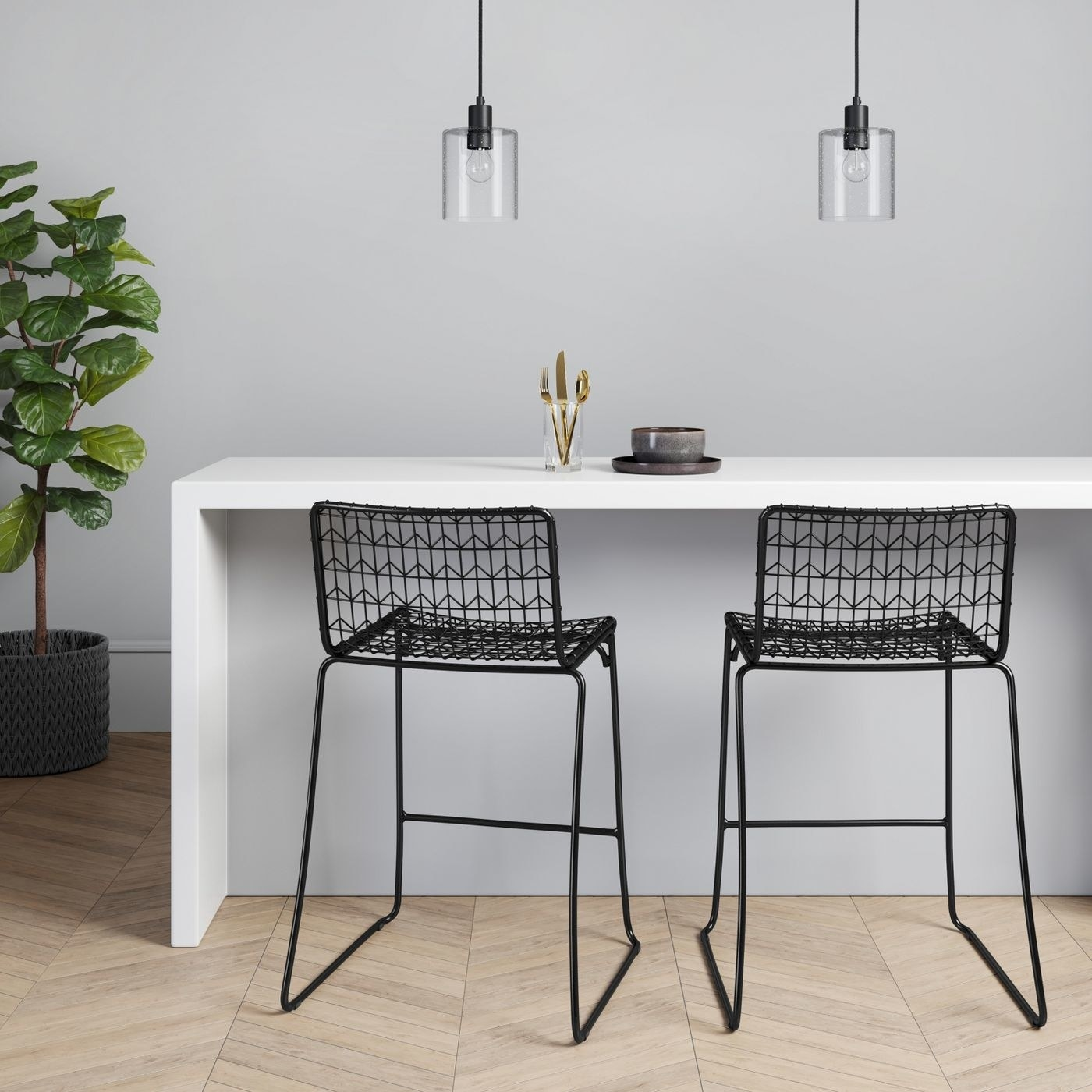 Two black oster wire bar stools