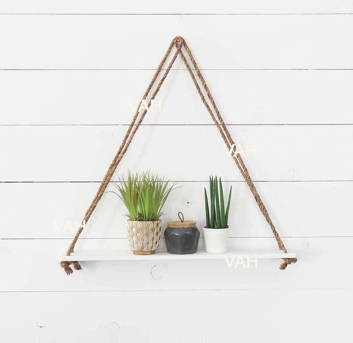 A triangular shelf on a wall