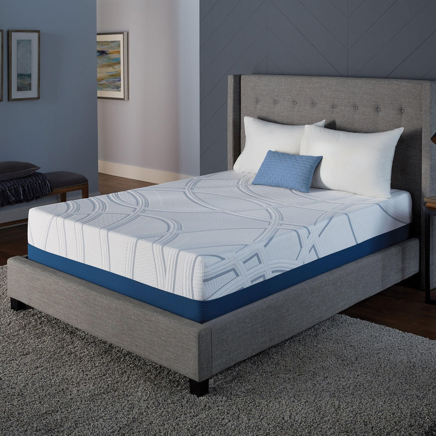 The mattress, set on top of a gray bed frame