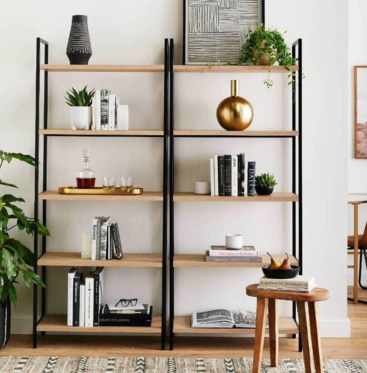 A ladder bookshelf with a black metal frame