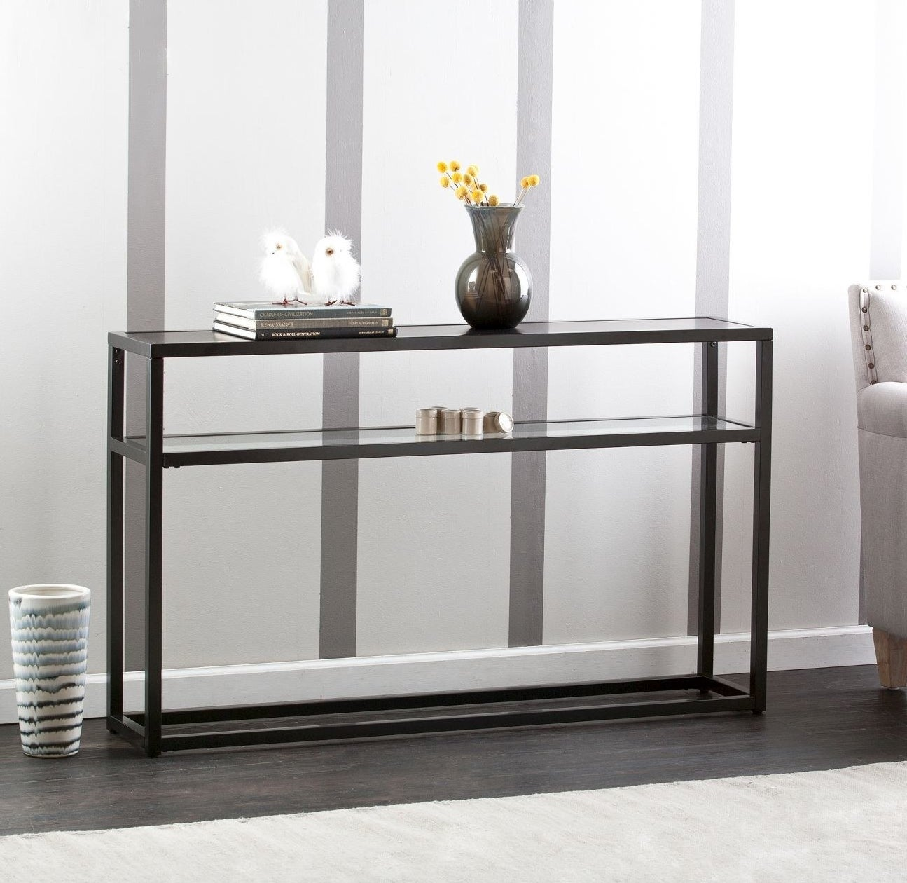 A black console table with a glass top