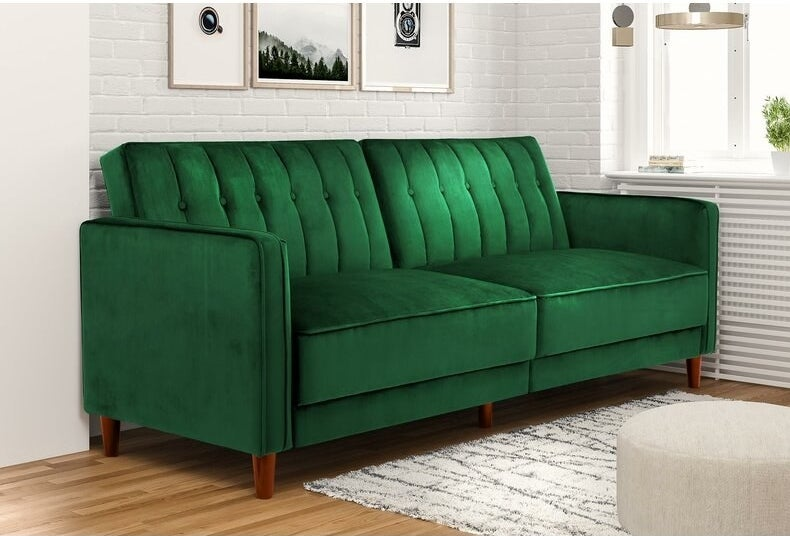 The couch in green, which has two seats, and small wooden peg legs