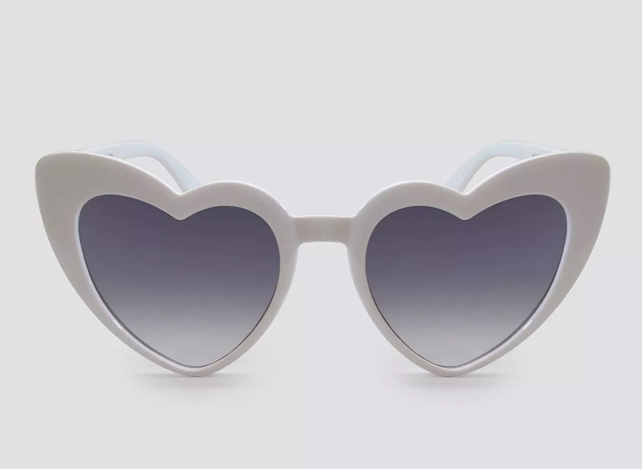 a pair of white heart shaped sunglasses