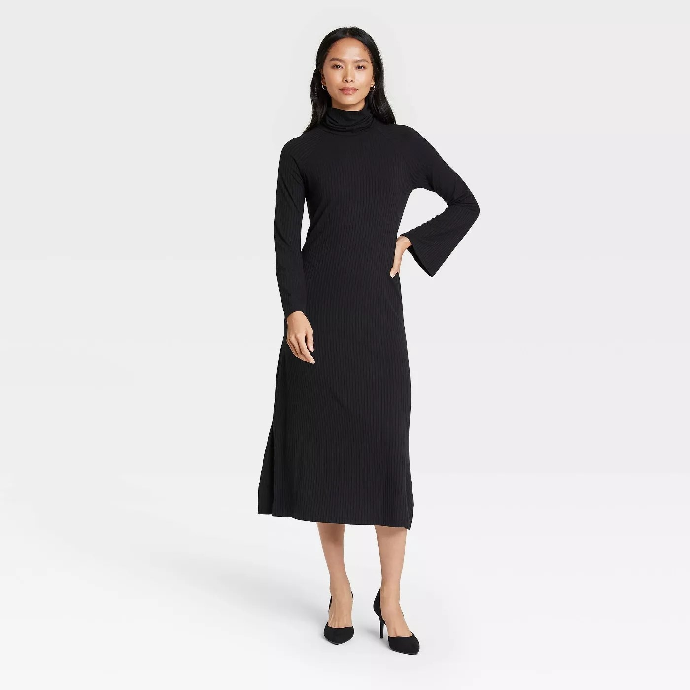 a model wears a black dress with bell sleeves