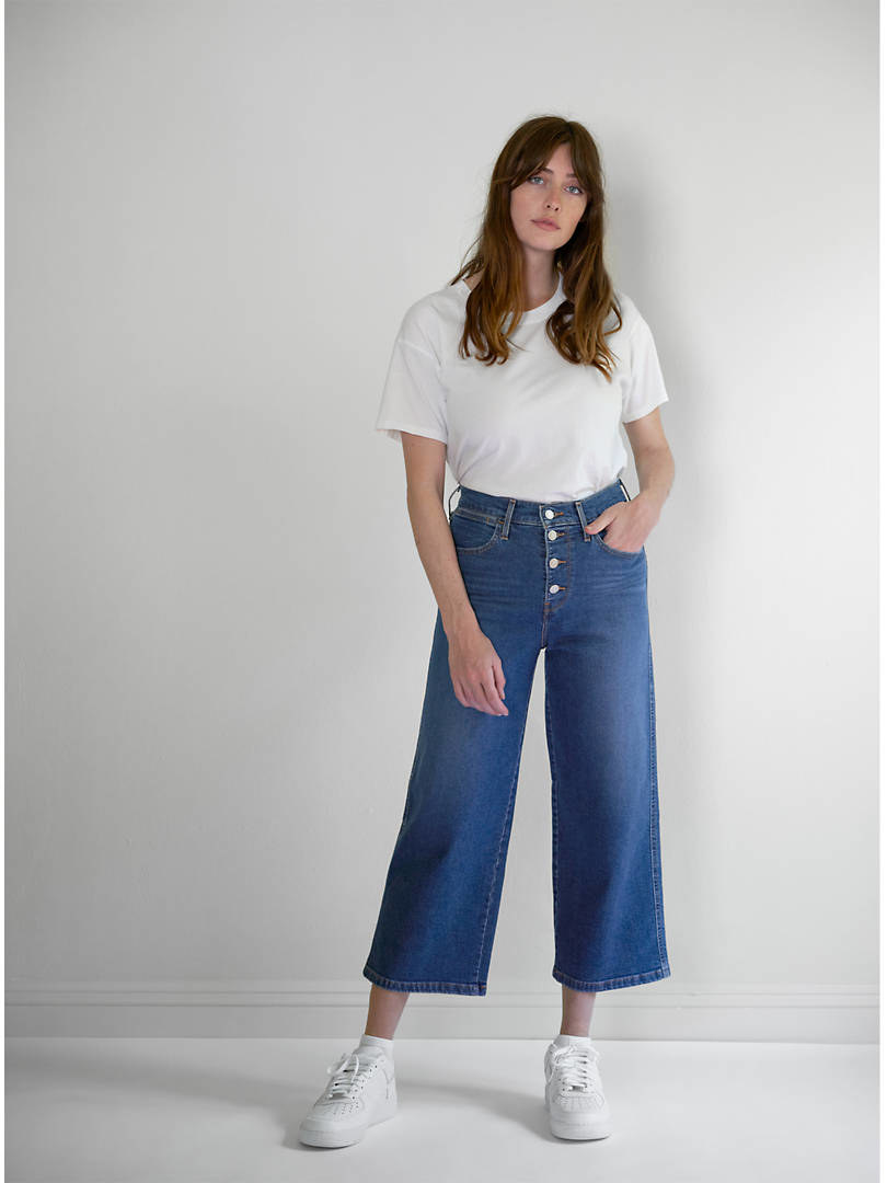 model wearing wide leg flair pants
