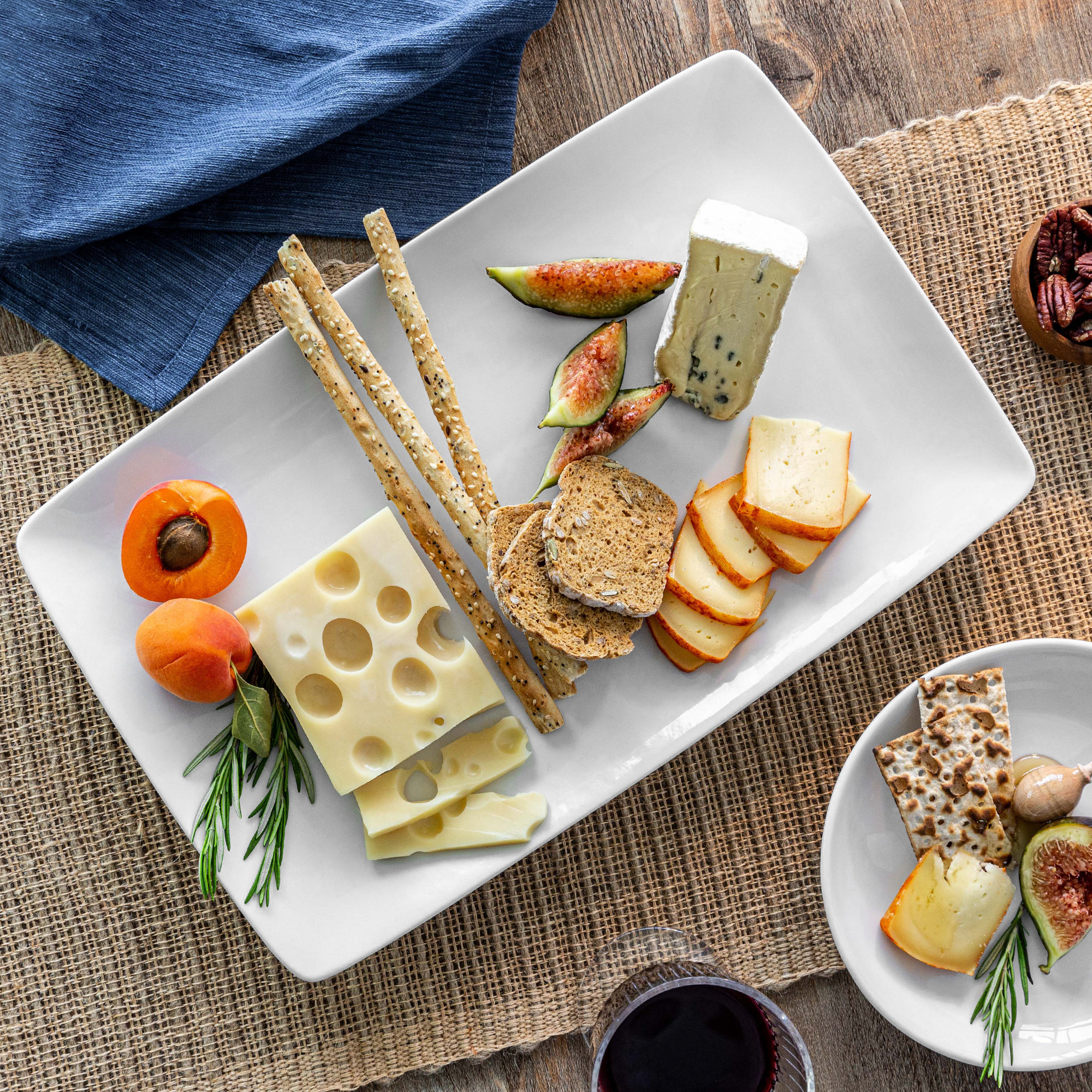 porcelain serve platter with cheese and snacks on it