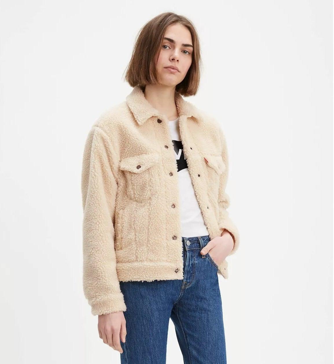 model wears sherpa trucker jacket