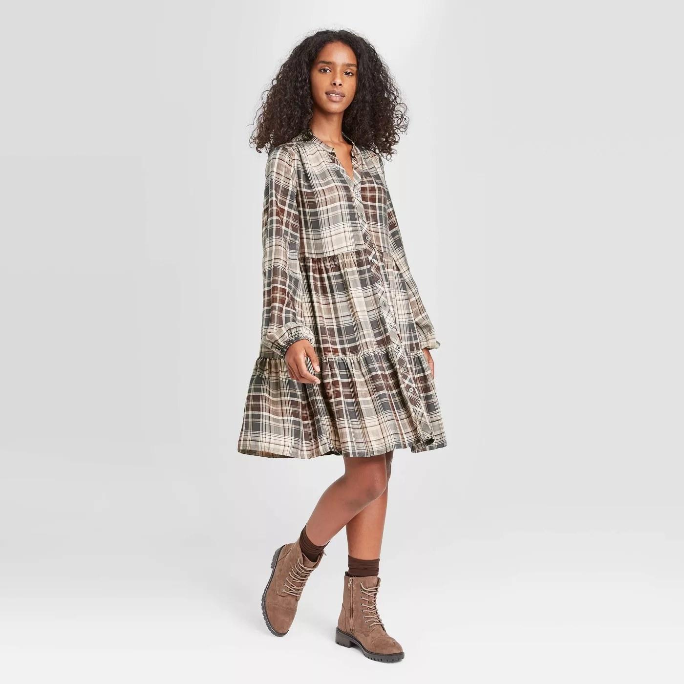 model wears plaid dress