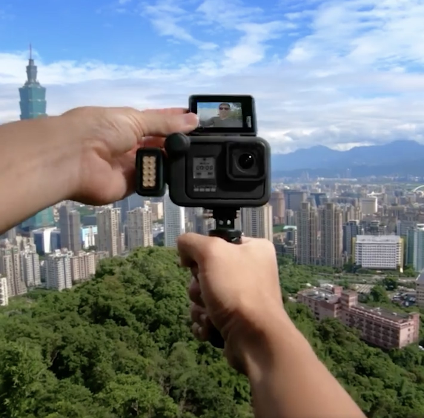 Person is holding a black GoPro